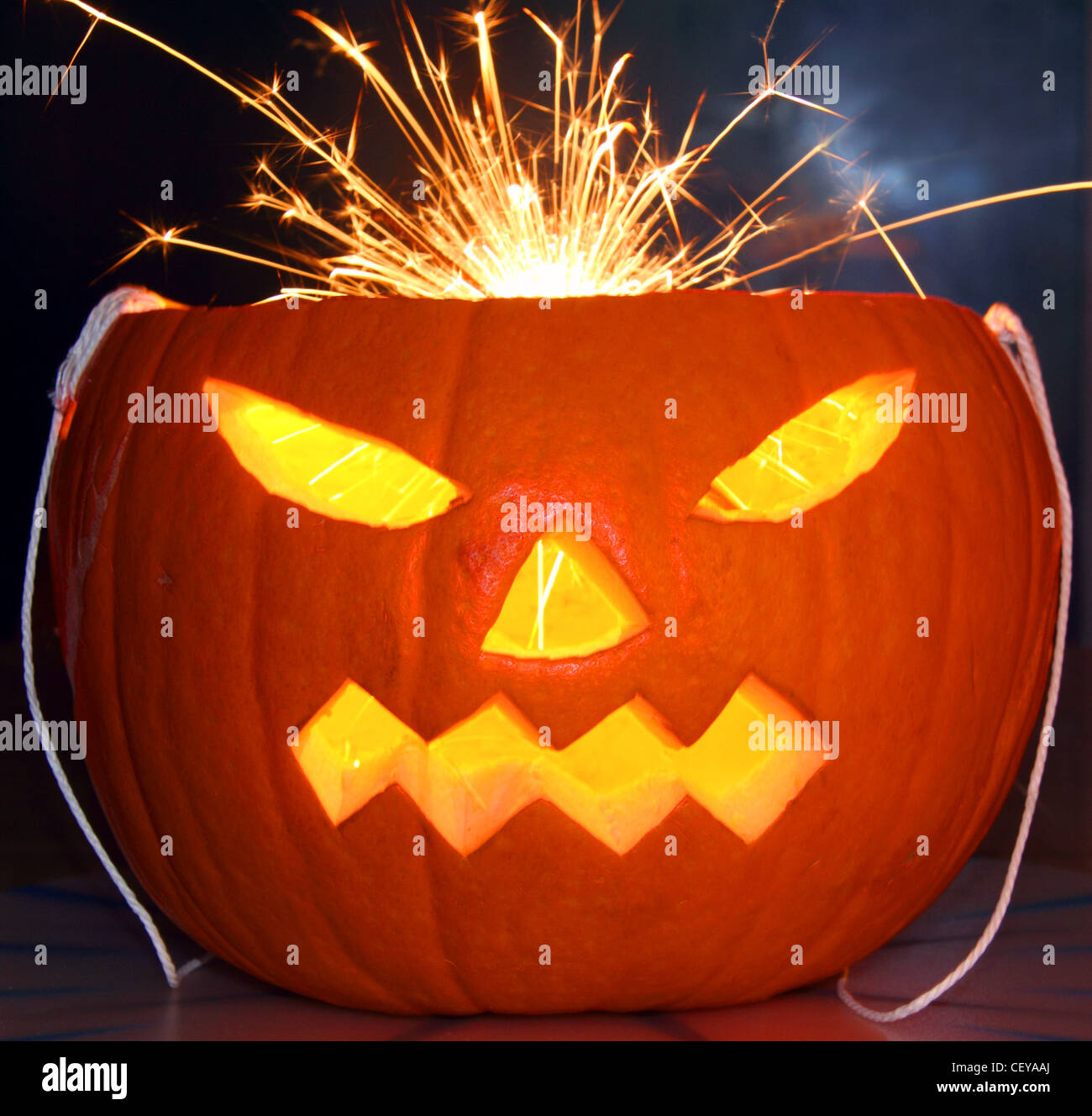 Orange,Halloween,Pumpkin,with,sparkler,for,hair,gotonysmith,carved,face,eyes,nose,mouth,pumpkin,all,hallows,allhalows,allhallows,carviing,ideas,decorating,Punkin,Attractive,craft,jack-o'-lantern,jack-o-lantern,jack-o,lantern,jacko,carving ideas,Pumpkin Carving Ideas,ignis,fatuus,or,will-o'-the-wisp,in,English,folklore,used,especially,in,East,Anglia,firework,sparkling,gotonysmith,Buy Pictures of,Buy Images Of