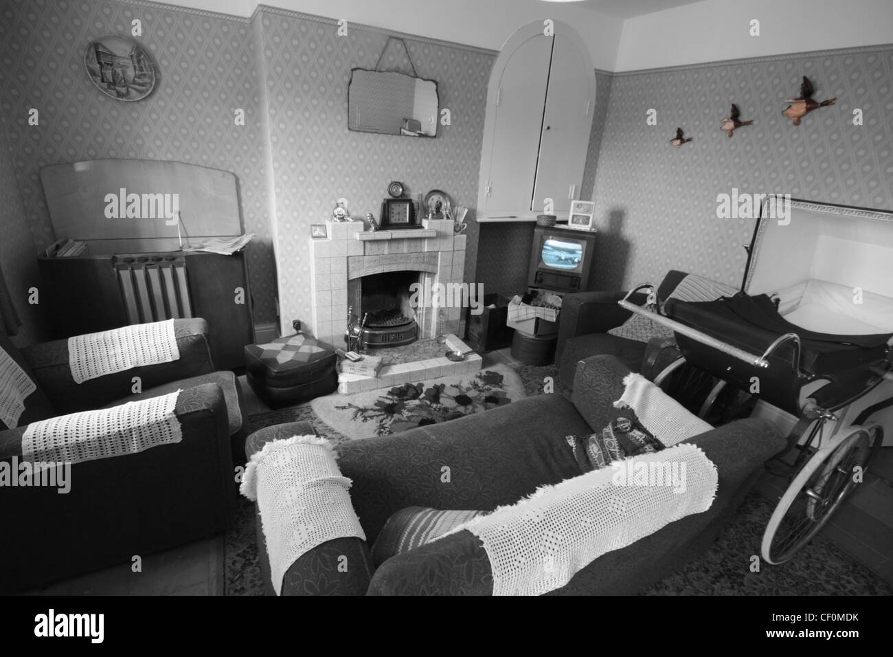 Example of a 1950's sitting room,complete,with,405,line,television,TV,405line,1950,1950s,fifties,austerity,old,old,fashioned,how,we,used,to,live,gotonysmith,selective,colour,color,classic,british,britain,UK,english,living,room,front,Selective color,selective colour,front room,sitting room,fireplace,fire,place,gotonysmith,fire place,Buy Pictures of,Buy Images Of