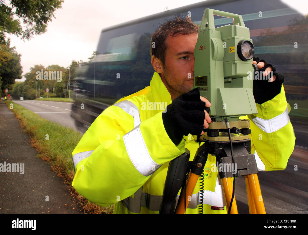 CWAC,local,authority,surveyor,on,A556,Northwich,bypass,looking,towards,Chester,with,Leica,survey,instrument.,Lorry,passing.,in,the,distance,gotonysmith,engineer,civil,Cheshire,West,and,Chester,Local,authority,Council,Road,Surveyor,using,Leica,803,Ultra,on,A556,near,Peover,road,side,roadside,highway,highways,dept,department,reflective,jacket,safety,hi-vis,hivis,high,visability,young,man,male,chap,british,England,work,working,worker,slowshutter,slow,shutter,working,at,work,cwac,cheshirewest,gotonysmith,at,work,working,surveying,speed,@hotpixuk,hotpixuk,concentrate,concentrating,yellow,jacket,florescent,safety,visible,Buy Pictures of,Buy Images Of