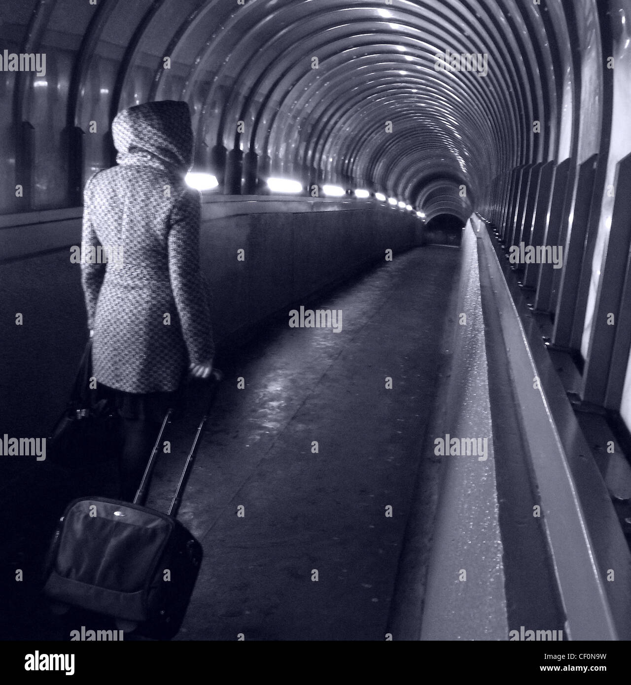 walker,at,Park,lane,Darlington,Passenger,Tunnel,with,luggage,Darlington,Station,Darlington,Teeside,England,UK,gotonysmith,british,lone,woman,female,lady,girl,bag,on,wheels,laptop,bag,suitcase,walk,walking,wheeling,vanishing,point,dark,night,evening,lights,cold spiral,gotonysmith,Buy Pictures of,Buy Images Of