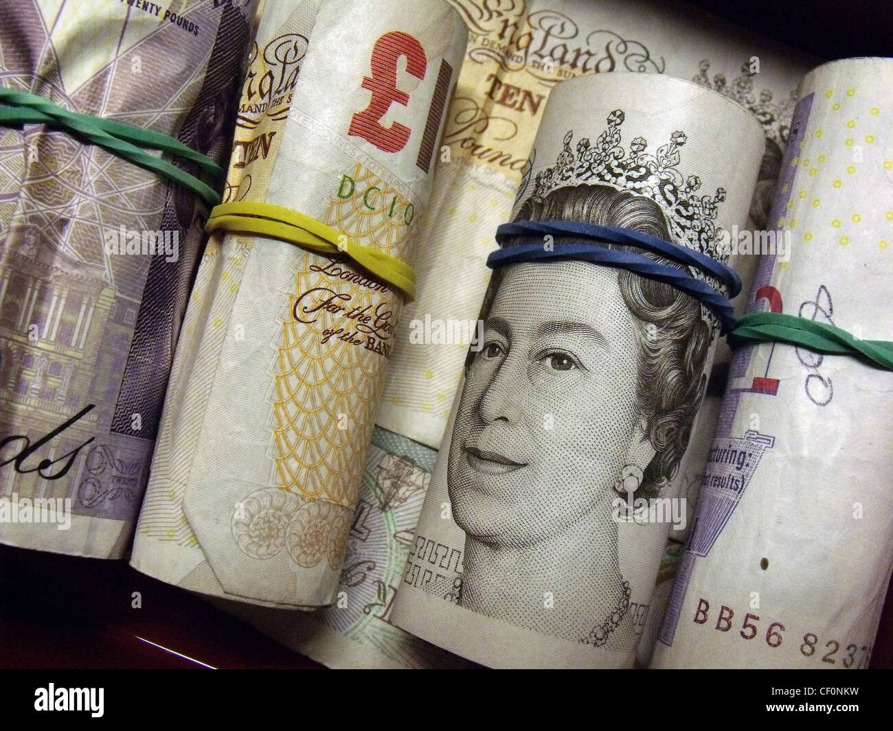 pounds,gotonysmith,queen,Elizabeth,of,England,bank,smile,note,money,notes,english,Britain,UK,Europe,close,up,mixture,black,economy,pay,paying,by,cash,£10,£20,used,ten,twenty,rolled,dosh,wonga,greenback,greenbacks,elastic,bands,rubber,gotonysmith,Buy Pictures of,Buy Images Of