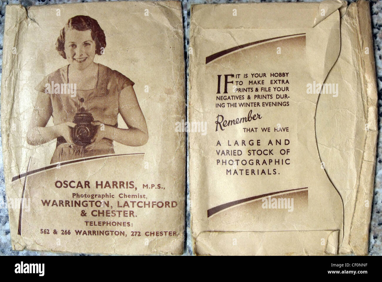 Oscar,Harris,shop,Latchford,Warrington,Cheshire,England,UK,gotonysmith,brown,film,processing,monochrome,roll,brownie,lab,chemists,chemist,shop,Latchford,Chester,old,way,style,woman,lady,holding,6x6,camera,box,if,it,is,your,hobby,to,make,extra,prints,print,negatives,negative,during,winter,evenings,large,stock,of,photographic,materials,gotonysmith,Buy Pictures of,Buy Images Of