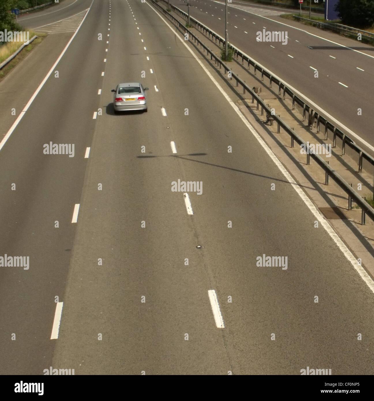 Single car on M1 at Watford Gap services,M1 Motorway,Northamptonshire,England UK road network gotonysmith,gotonysmith,Buy Pictures of,Buy Images Of