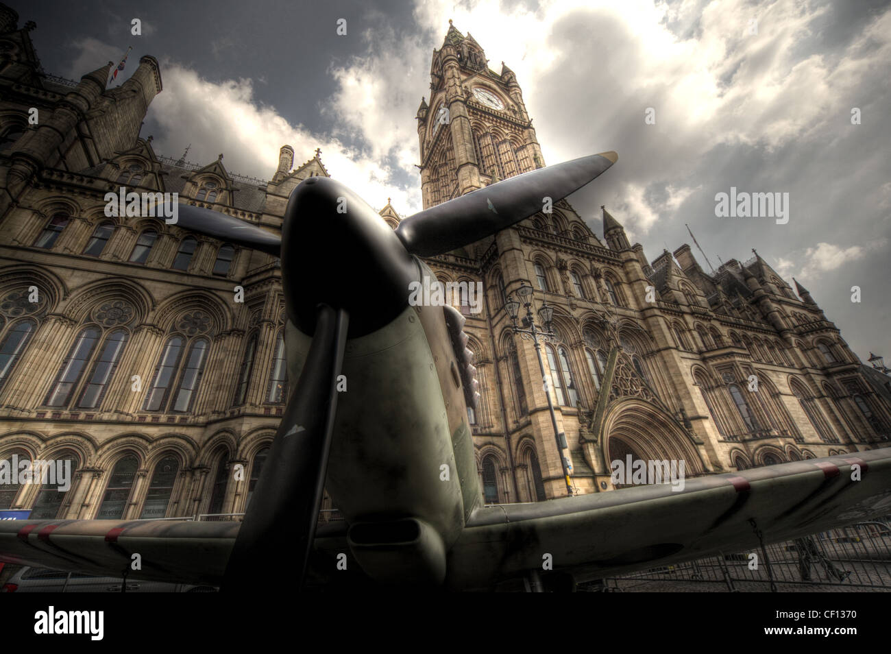 Spitfire aircraft in front of Manchester town hall,Albert Square,Lancashire,England,UK,gotonysmith,north,west,northwest,england,MOD,military,air,force,drama,best,dramatic,Manchester,Town,Hall,is,a,Victorian-era,Neo-gothic municipal building in Manchester England building,Manchester Town Hall is a Victorian-era,Neo-gothic municipal building in Manchester,England.,The,building,functions,as,the,ceremonial,headquarters,of,Manchester,City,Council,and,houses,a,number,of,local,government,departments.,Designed,by,architect,Alfred,Waterhouse,the,town,hall,was,completed,in,1877.,The,building,occupies,a,triangular,site,facing,Albert,Square,and,contains,offices,and,grand,ceremonial,rooms,such,as,the,Great,Hall,which,is,decorated,with,the,imposing,Manchester,Murals,by,Ford,Madox,Brown,illustrating,the,history,of,the,city.,The,entrance,and,Sculpture,Hall,contain,busts,and,statues,of,influential,figures,including,Dalton,Joule,and,Barbirolli.,The,exterior,is,dominated,by,the,clock,tower,which,rises,to,87,metres,(285,feet),and,houses,Great,Abel,the clock bell.,gotonysmith,Buy Pictures of,Buy Images Of