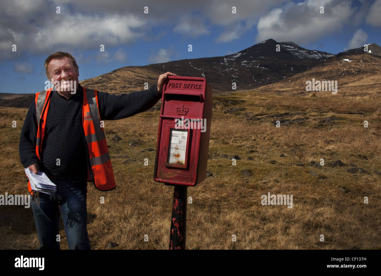 Alastair,Isle,Of,Mull,Postie,postman,western,Scotland,UK,gotonysmith,rural,country,countryside,round,van,royal,mail,post,office,red,box,pillar,pillarbox,grass,mountains,collect,collecting,letters,empty,emptying,smile,face,smiling,man,woman,gotonysmith,Buy Pictures of,Buy Images Of,The Isle of Mull or simply Mull (Scottish Gaelic Muile,pronounced,) is the second largest island of the Inner Hebrides,off,the,west,coast,of,Scotland,in,the,council,area,of,Argyll,and,Bute.,With,an,area,of,875.35,square,kilometres,(337.97,sq,mi),Mull,is,the,fourth,largest,Scottish,island,and,the,fourth,largest,island,surrounding,Great,Britain.,In,the,2001,census,the,usual,resident,population,of,Mull,was,2,667,in,the,summer,this,is,supplemented,by,many,tourists.,Much,of,the,population,lives,in,Tobermory,the only burgh on the island until 1973,and,its,capital.,Tobermory,is,also,home,to,Mulls,only,single,malt,Scotch,whisky,distillery,Tobermory (formerly Ledaig),ˈmulə