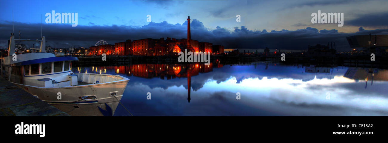 Albert,Dock,Liverpool,Dusk,Panorama,from,Wapping,Merseyside,North west England,UK,gotonysmith,blue,hour,pump,house,pub,water,maritime,beatles,city,dock,harbour,side,harbourside,john,lennon,chimney,Albert,Dock,is,a,complex,of,dock,buildings,and,warehouses,in,Liverpool,England.,Designed,by,Jesse,Hartley,and,Philip,Hardwick,it,was,opened,in,1846,and,was,the,first,structure,in,Britain,to,be,built,from,cast,iron,brick and stone,with,no,structural,wood.,As,a,result,it,was,the,first,non-combustible,warehouse,system,in,the,world.,At,the,time,of,its,construction,the,Albert,Dock,was,considered,a,revolutionary,docking,system,because,ships,were,loaded,and,unloaded,directly,from/to,the,warehouses.,Two,years,after,it,opened,it,was,modified,to,feature,the,worlds,first,hydraulic,cranes.,Due,to,its,open,yet,secure,design,the,Albert,Dock,became,a,popular,store,gotonysmith,Buy Pictures of,Buy Images Of