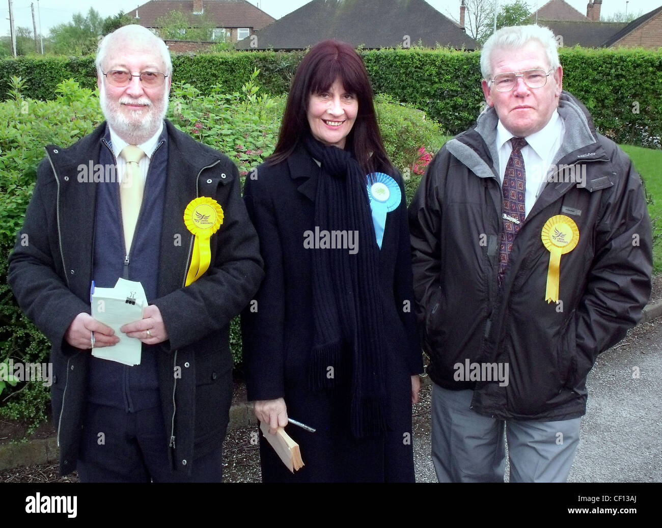 Local election candidates Liberal Tory (Conservative) outside Grappenhall polling station,Grappenhall Library,South,warrington,gotonysmith,borough,council,westminster,ward,rosettes,rosette,yellow,woman,canvas,canvassing,Ian,Fountain,Grappenhall,Heys,walled,garden,The,local,Warrington,Borough,Council,elections,also,took,place,that,day.,WBC,closed,Grappenhall,library,less,than,a,year,later.,Parish,council,collation,hung,parliament,Friends,of,Grappenhall,library,librray,gotonysmith,Buy Pictures of,Buy Images Of