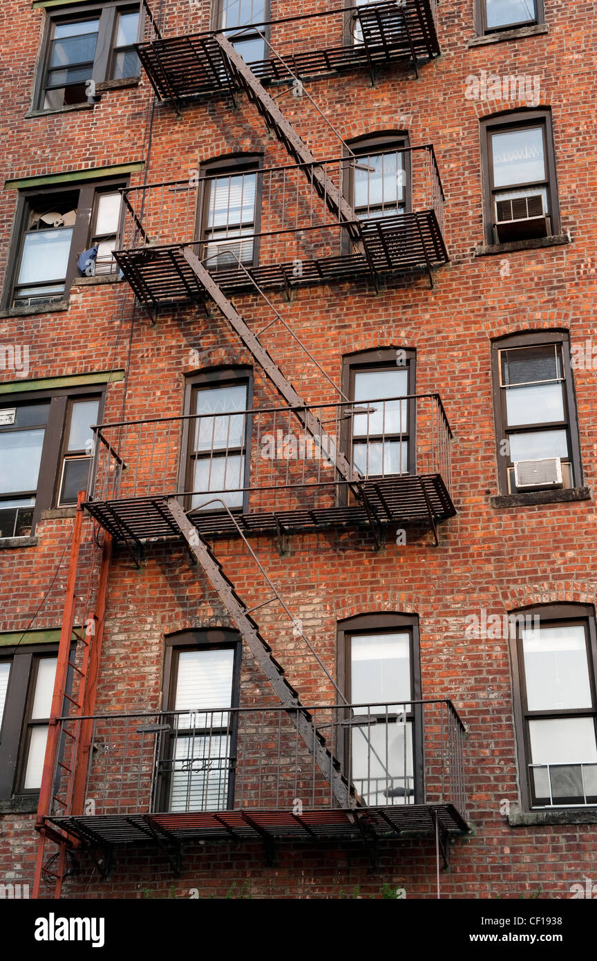 Fire Escape Ladders On Side Of Brick Apartment Buildings