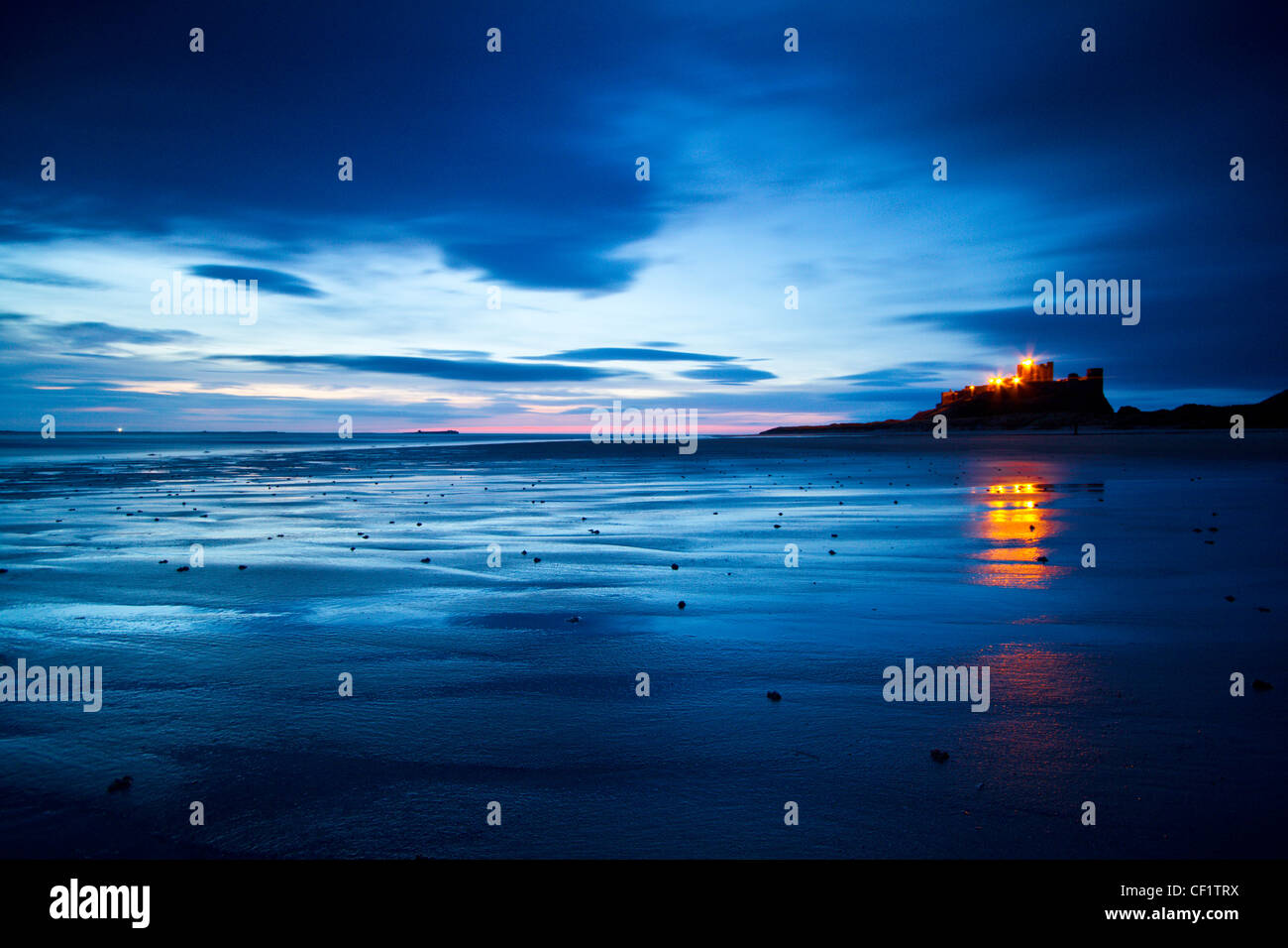 Bamburgh Castle, one of Northumberland's most iconic buildings just before sunrise. - Stock Image