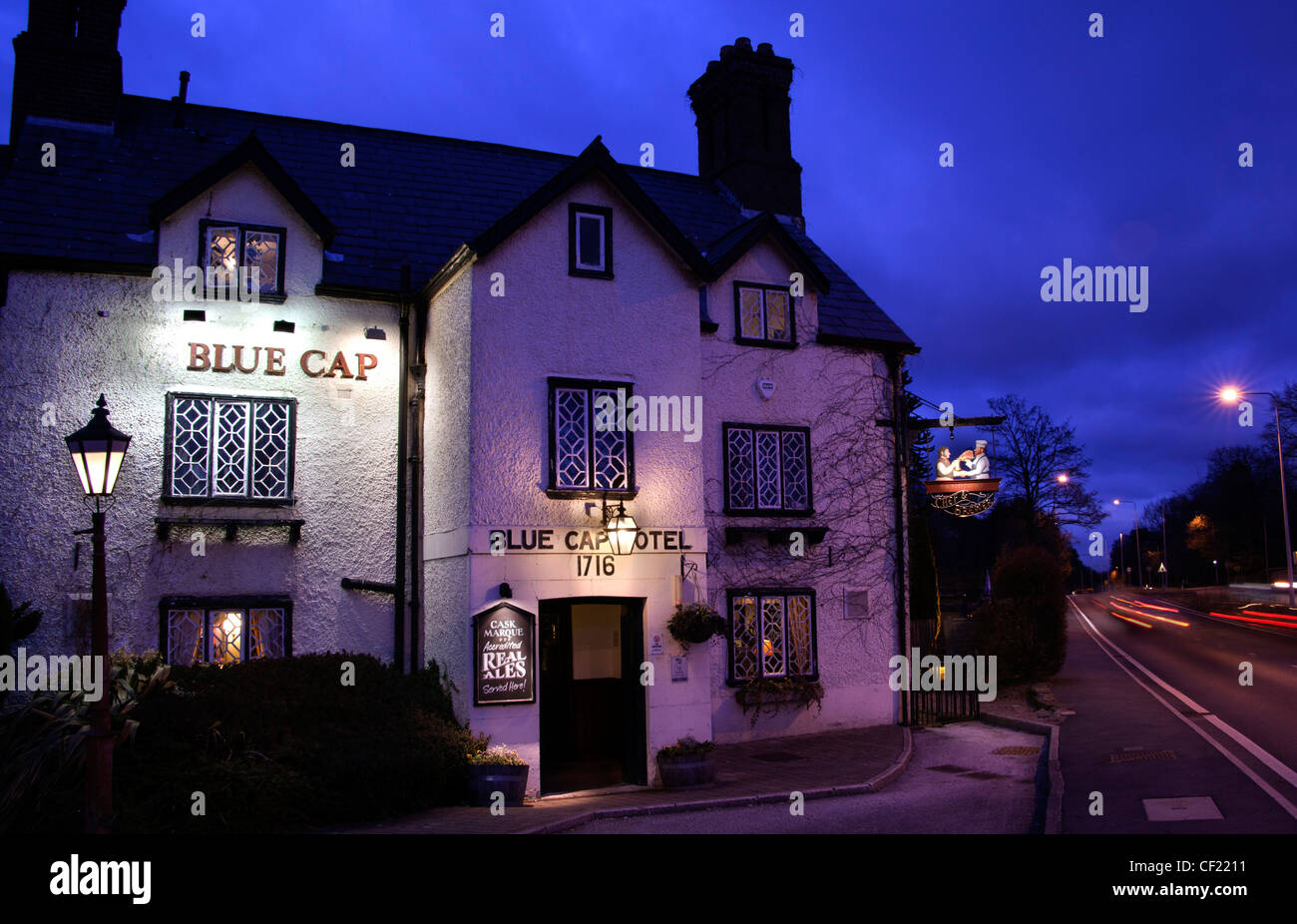 Blue Cap historic Pub and drinking place A556 at Dusk,Cheshire,England,United Kingdom gotonysmith Blue Cap,Cheshire,named,after,a,noted,18th,century,foxhound,marked,with,a,dark,patch,on,its,head,night,shot,blue,hour,bluehour,near,road,fast,country,inn,tourist,attraction,Blue,Cap,Pub,A556,Dusk,The,Blue,Cap,in,Cheshire,was,named,after,a,noted,18th,century,foxhound,marked,with,a,dark,patch,on,its,head,ales,CAMRA,public,house,Dark,beer,gotonysmith,Buy Pictures of,Buy Images Of