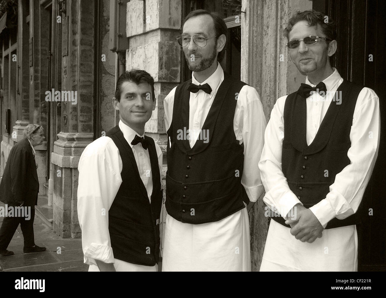 Three,waiters,of,various,sizes,in,B/W,black,and,white,&,gotonysmith,3,sizes,staff,catering,bow,tie,jackets,waistcoats,waist,coats,bowtie,Brussels,London,strange,best,most,interesting,special,something,gotonysmith,Buy Pictures of,Buy Images Of