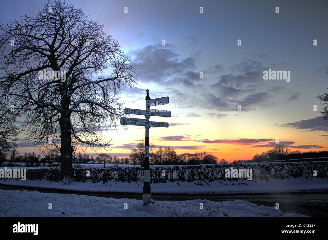 Snowy,winter,Cheshire,tree,trees,gotonysmith,Sunset,blue,oramge,sky,dusk,lane,country,snow,ice,winter,cold,orange,english,scene,road,England,finger,post,old,style,road,signage,Budworth,Sunset,And,Fingerpost,finger,gotonysmith,Buy Pictures of,Buy Images Of