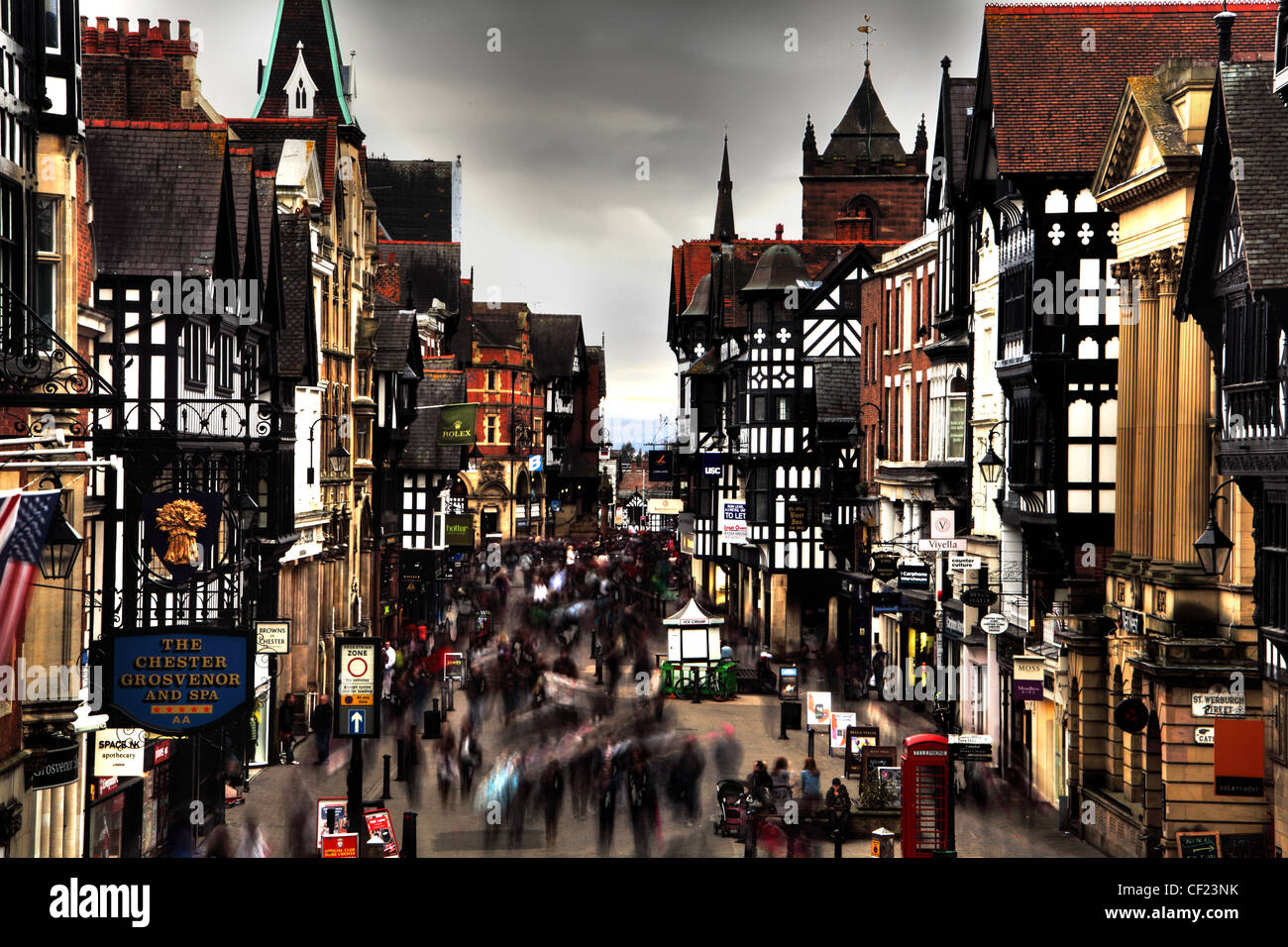 Chester,city,shoppers,rushing,around,and,going,about,their,business,in,Northgate,Street,where,it,meets,Frodsham,St.,Cheshire.,Historic,walled,wall,city,English,england,tourist,shop,shops,shopping,gotonysmith,Timber,rows,building,Grosvenor,hotel,mall,malls,pedestrianized,lane,ole,olde,Eastgate,buildings,pedestrianised,river,Dee,Eastgate,East,gate,walls,walled,tour,tourest,authority,tourist,image,best,greatest,interesting,different,slow,motion,shutter,long,exposure,gotonysmith,City Centre,City,Centre,@hotpixUK,Buy Pictures of,Buy Images Of