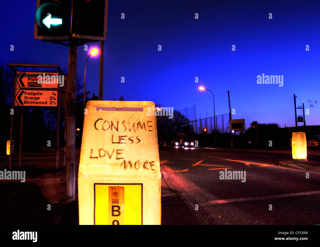 Comsume Less Love More scrawled on a road beacon,Padgate,/,Birchwood,A57,Warrington,at,Dusk,gotonysmith,Grange,Woolston,WBC,Warrington,Borough,Council,Unitary,Authority,LA,Local,dusk,blue,hour,night,nighttime,time,roadway,gotonysmith,Buy Pictures of,Buy Images Of,drive,driving,road,Maybe,a,mantra,for,our,current,troubled,times?,Perhaps,we,should,worry,about,our,carbon,footprint,walk,a,bit,more,rather,than,drive,as,much?,Possibly,eat,less,supermarket,food,consume,in,season,and,cut,down,on,our,food,air,miles,?,Think,more,about,our,neighbours,come to think of it,do,you,even,know,your,neighbours?,Some,of,our,prejudges,should,maybe,be,put,aside,the,world's,more,interesting,when,it's,diverse.,I,must,have,passed,this,on,Orford,road,coming,into,Padgate,Warrington,Cheshire,a,few,dozen,times.,To,stop,at,the,traffic,lights,makes,you,consider,these,four,words,a,little,more,deeply.,Next,time,you,wait,there,to,follow,the,A50,or,to,go,to,Birchwood,following,the,A574,consider these words.