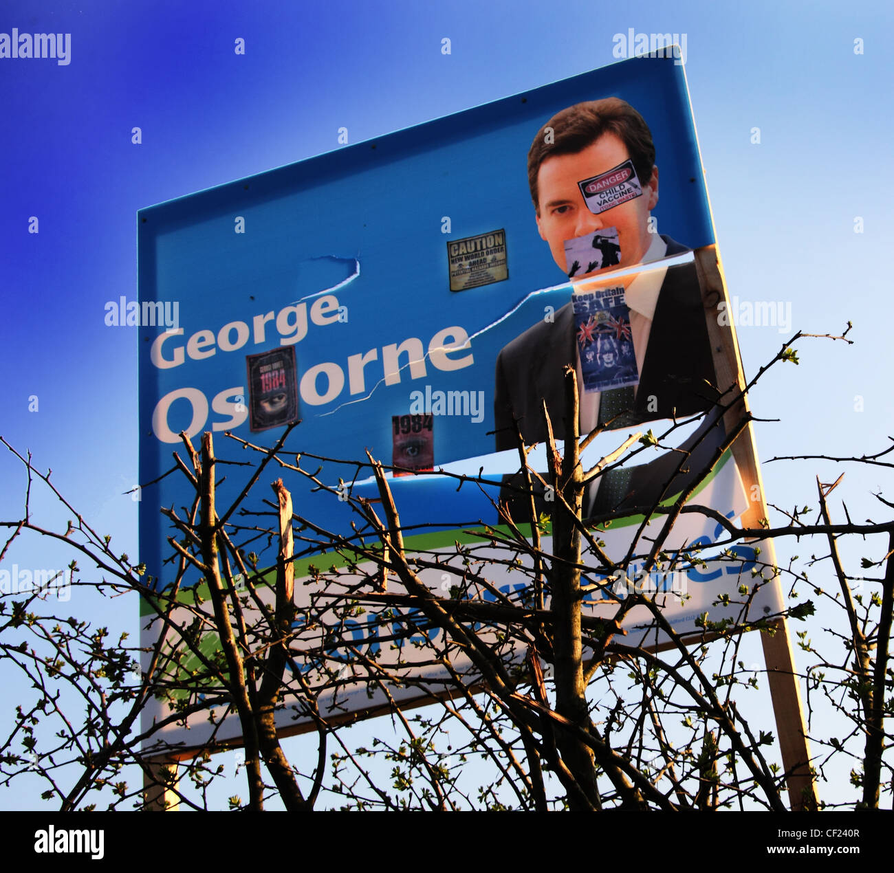 Defaced,2010,Election,Poster,for,George,Gideon,Osbourne,now,elected,MP,and,Conservative,Chancellor,for,Tatton,Ward,Cheshire,gotonysmith,farmers,field,protest,shot,hate,tory,hatred,hated,rich,career,knutsford,pickmere,Northwich,campaign,trail,George,Gideon,Oliver,Osborne,British,Conservative,politician.,He,is,the,Chancellor,of,the,Exchequer,of,the,United,Kingdom,a,role,to,which,he,was,appointed,in,May,2010,and,has,been,the,Member,of,Parliament,for,Tatton,since,2001,Osborne,is,part,of,the,old,Anglo-Irish,aristocracy,and,is,heir,to,the,Osborne,baronetcy.,educated,at,St,Pauls,School,and,Magdalen,College,Oxford,father,Sir Peter Osborne,17th Baronet,co-founded,the,firm,of,fabric,and,wallpapers,designers,Osborne,&,Little,gotonysmith,George,Gideon,Oliver,Osborne,Buy Pictures of,Buy Images Of