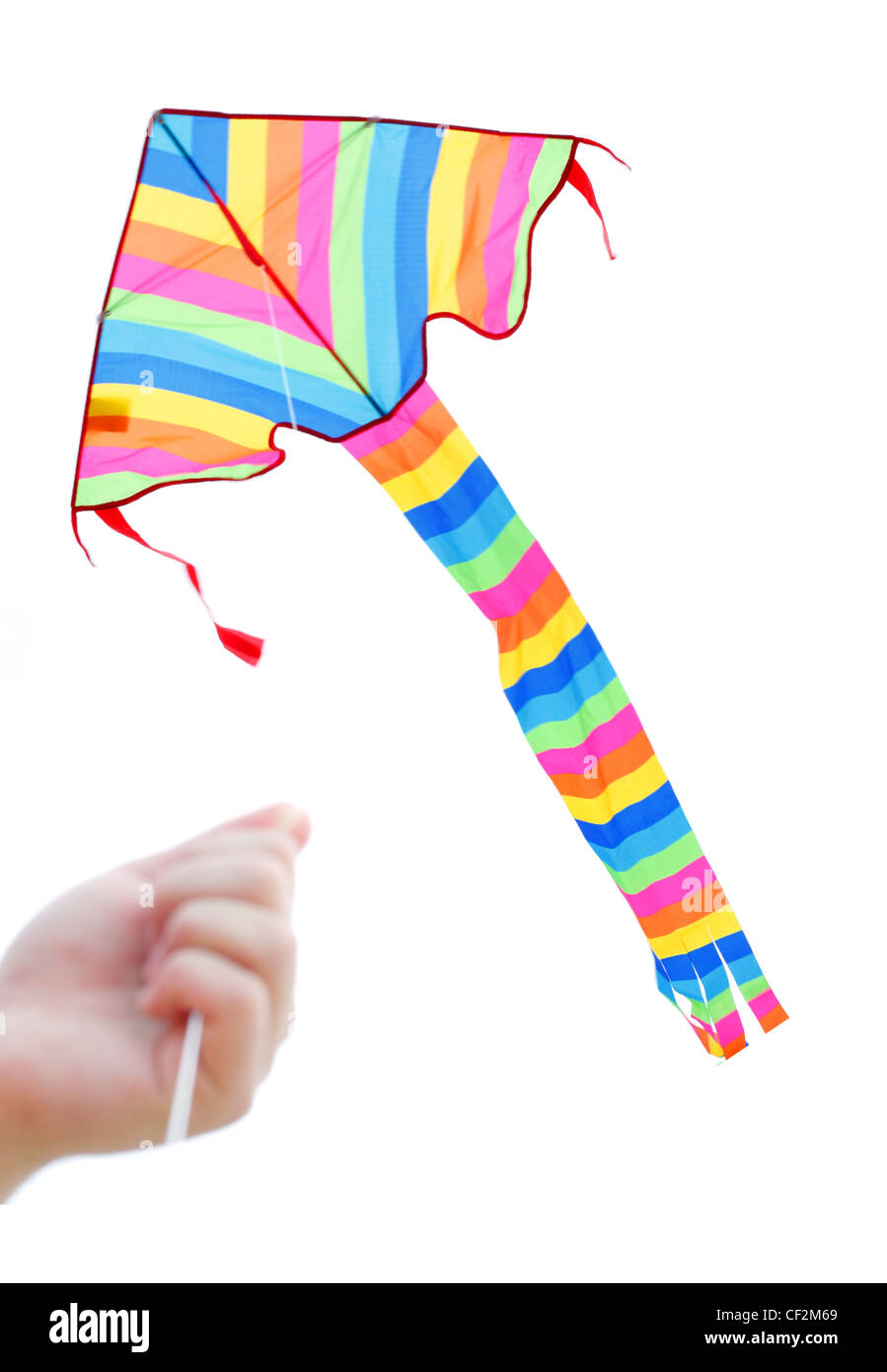 A boy playing with a kite - Stock Image