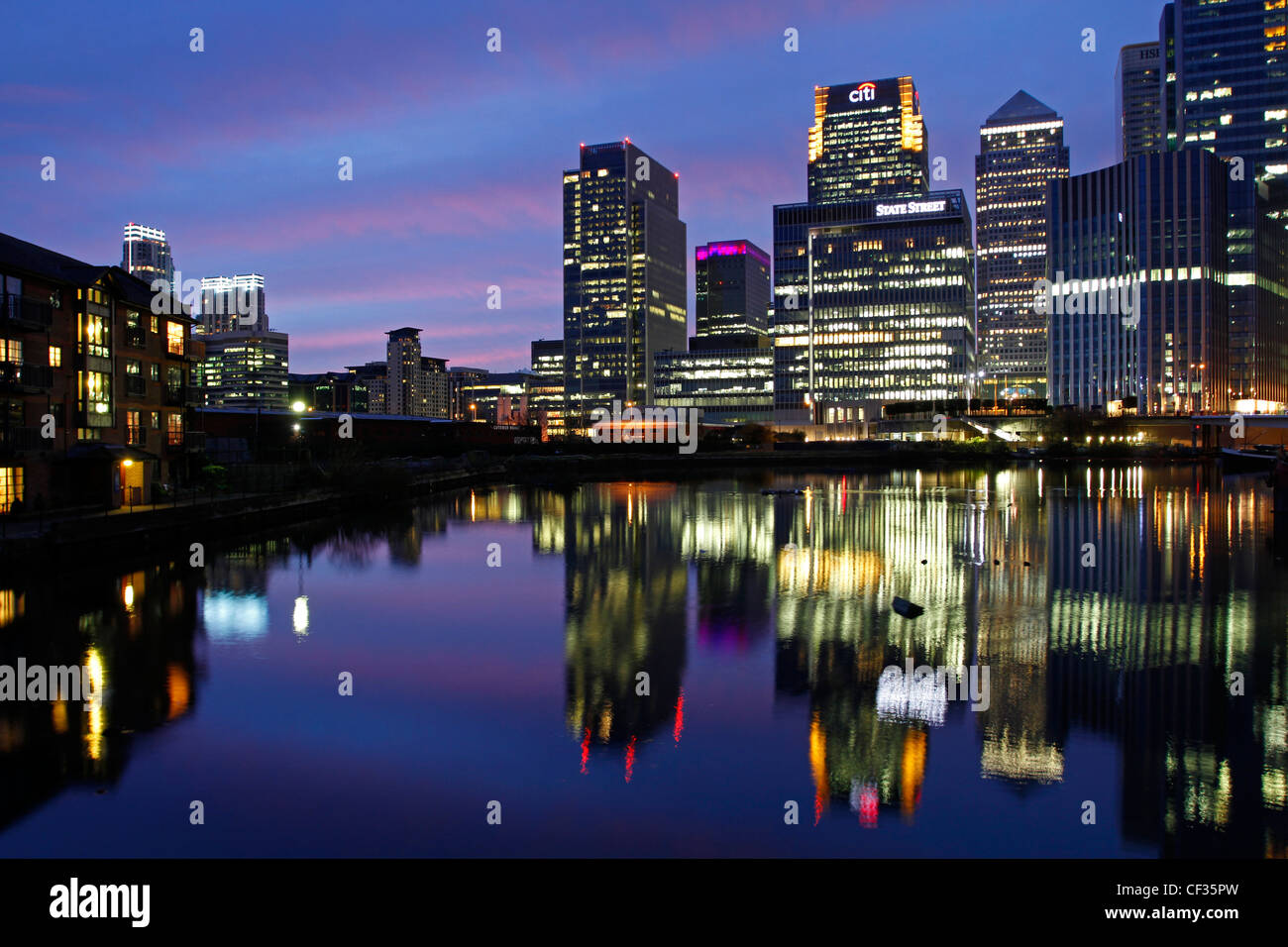 Skyscrapers at Canary Wharf illuminated at dusk. - Stock Image