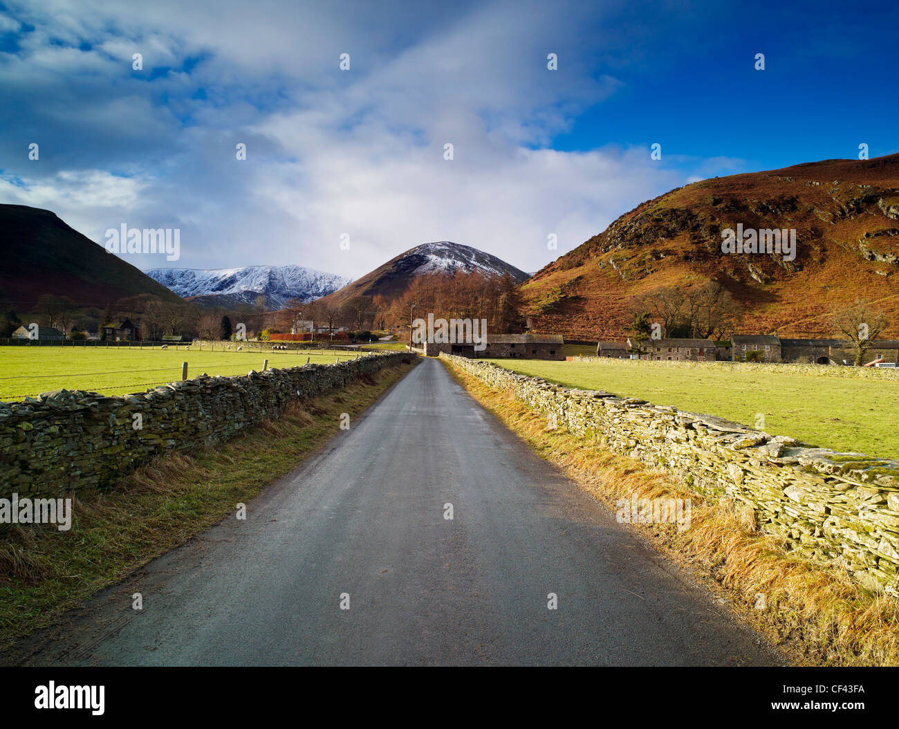 Looking along a quiet lane towards the remote Cumbrian village of Mungrisdale in the Lake District. - Stock Image