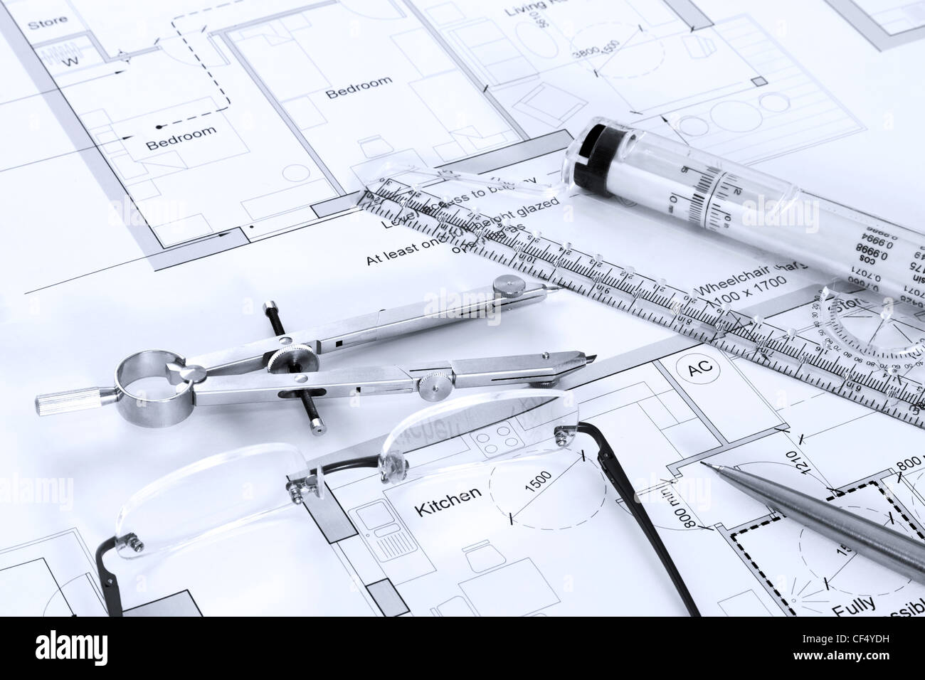 Still life photo of architectural floor plans with drawing instruments - Stock Image