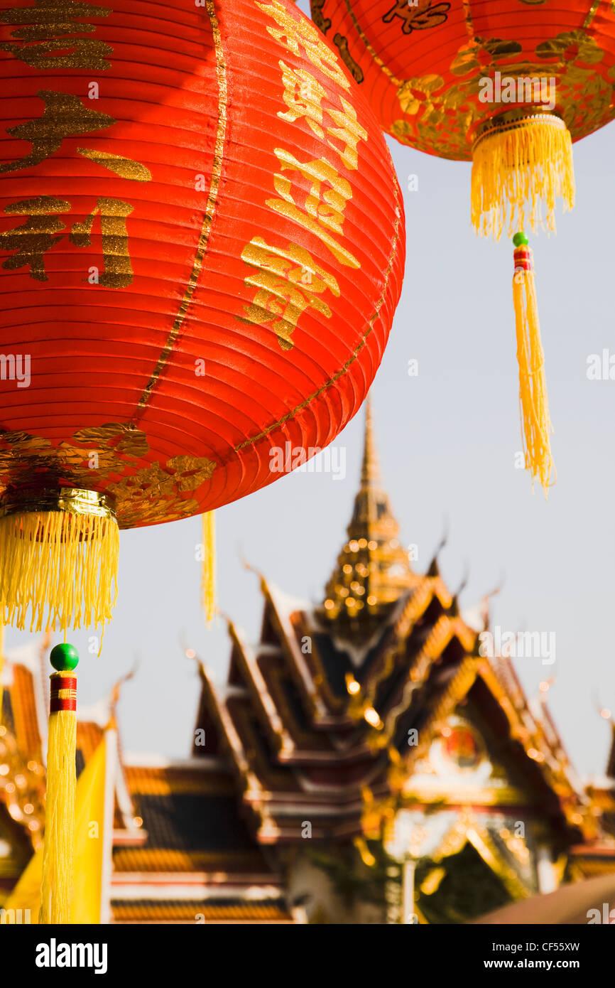 Thailand, Bangkok, Wat Yannawa temple roof and red paper lantern at Chinese New Year. - Stock Image