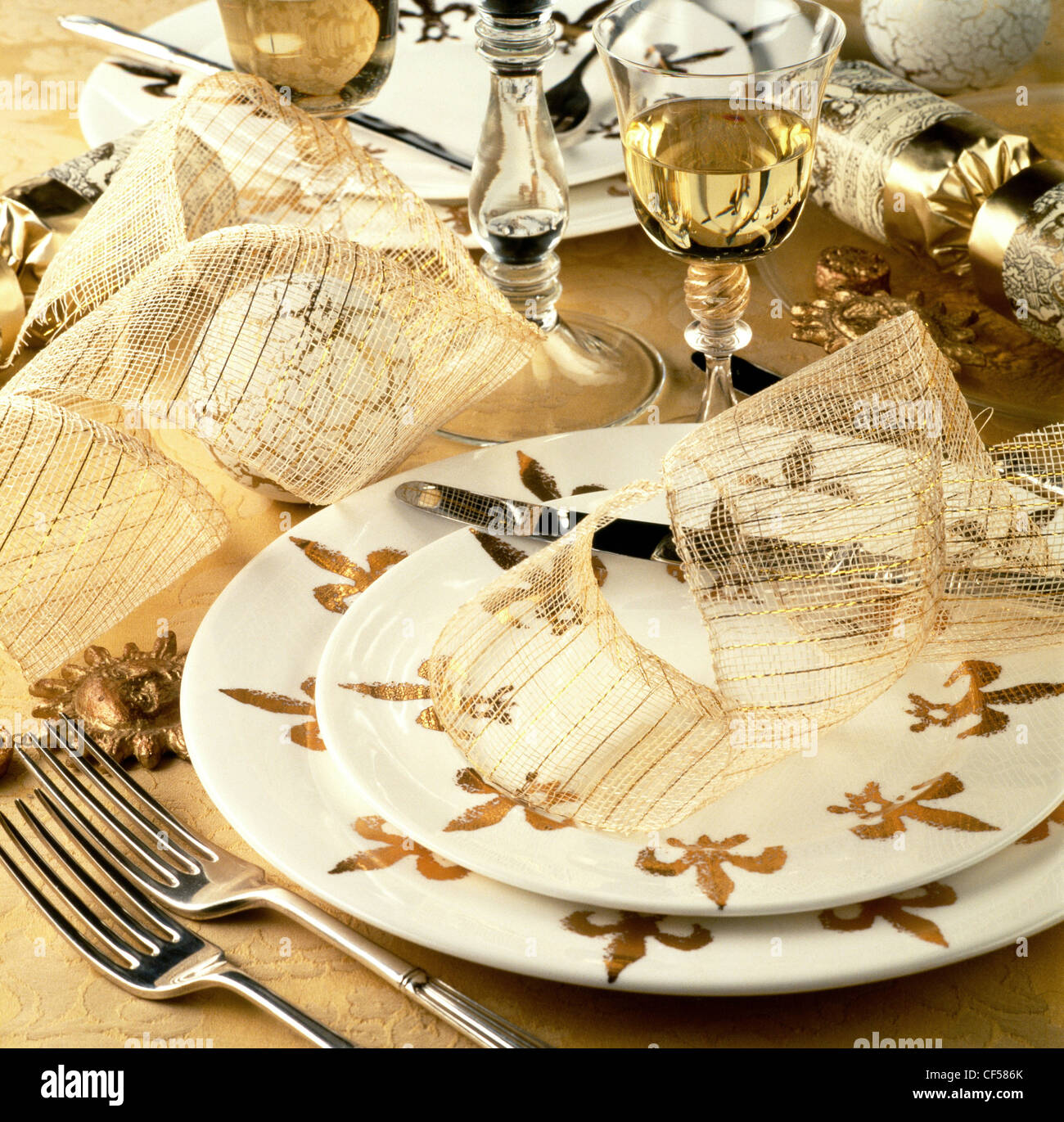 A special gourmet feast Table setting with white and gold fleur de ...