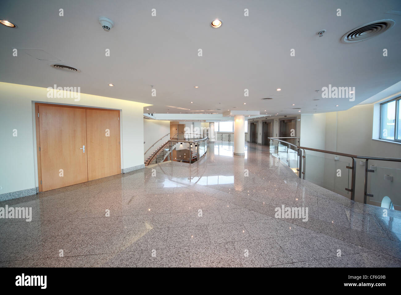 Big and light hall with  ladder and  front entrance in  conference room - Stock Image