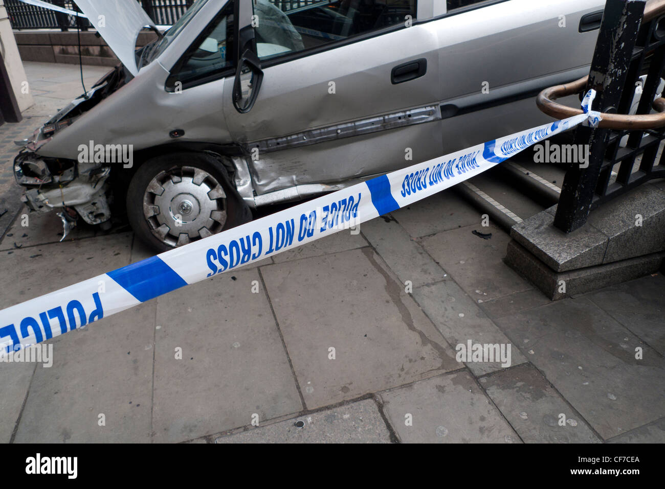 A crashed car cordoned off by a Police Do Not Cross line sign in London England UK  KATHY DEWITT - Stock Image