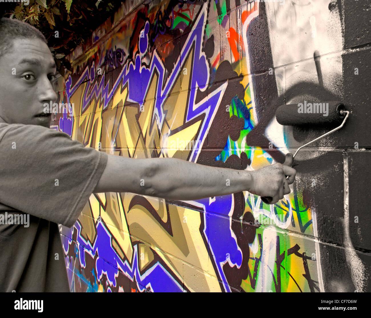 Removing,colourful,graffiti,with,a,paint,roller,covered,in,black,paint,Potterrow,Edinburgh,Lothian,Scotland,gotonysmith,uni,university,urban,hell,banksy,graffiti,artist,mono,monochrome,hero,LEcosse,Edimbourg,Schotland,Schottland,La,Scozia,Edimburgo,Escocia,Edimburgo,gotonysmith,Buy Pictures of,Buy Images Of