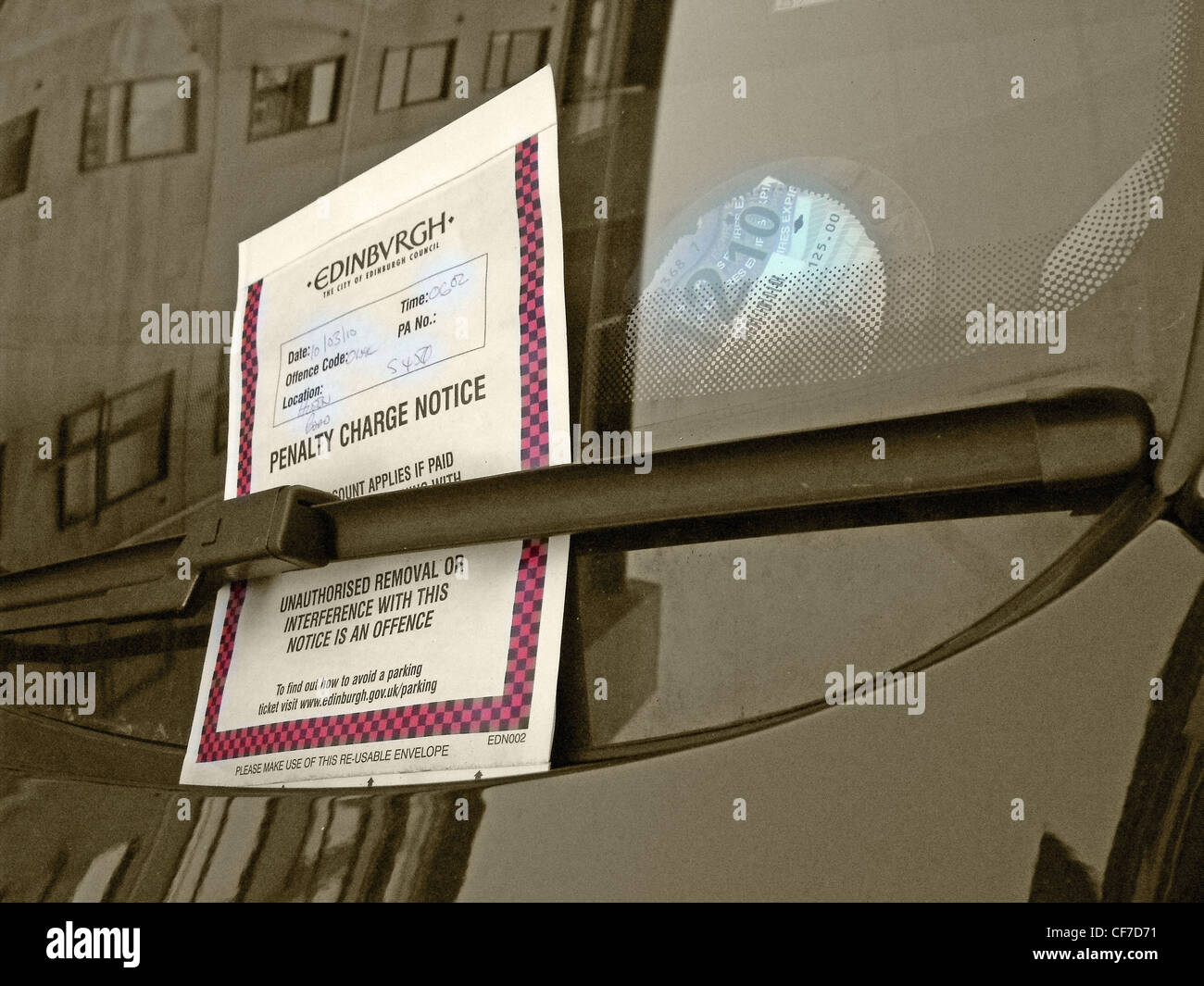 Edinburgh,parking,ticket,on,a,car,under,a,windscreen,wiper,in,Hulton,Road,Holyrood,Edinburgh,Scotland,UK,parking,warden,penalty,charge,notice,gotonysmith,do,not,remove,robbery,raising,cash,council,councils,local,authorities,authority,ripoff,britain,motorist,pay,paying,more,RAC,AA,LEcosse Edimbourg Schotland Schottland La Scozia Edimburgo Escocia Edimburgo,gotonysmith,Buy Pictures of,Buy Images Of