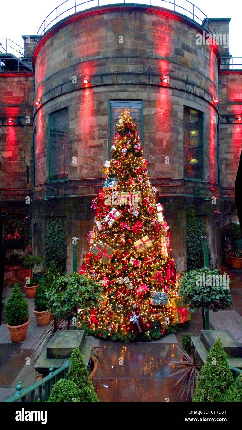 Edinburgh,Scotland,lothian,lothians,rear,gotonysmith,December,winter,festive,presents,LEcosse,Edimbourg,Schotland,Schottland,La,Scozia,Edimburgo,Escocia,Edimburgo,Dome Club Christmas tree,Edinburgh,Scotland in red,lit,by,lights,Xmas,This,tree,is,at,the,rear,of,the,Dome,and,can,be,viewed,from,Rose,Street,in,Edinburgh.,In,summer,it,is,an,upmarket,outdoor,eating,area,gotonysmith,The Dome is a bar,restaurant,and,conference,complex,and,was,originally,the,long,since,defunct,Commercial,Bank,of,Scotlands,HQ,At,Christmas,the,exterior,on,George,Street,and,the,interior,are,both,lavishly,decorated,As,you,enter,the,building,there,is,a,distinct,whiff,of,cinnamon,Buy Pictures of,Buy Images Of