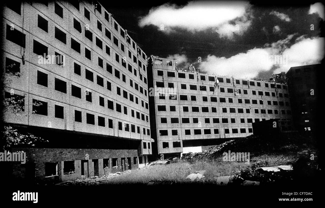 Concrete,Deck,Access,Council,Housing,ready,for,demolition,East,Manchester,Lancashire,England,UK,with,dramatic,sky,detail,high,density,housing,estate,flats,multi,storey,level,prefab,pre-fab,disaster,1960,1970,1960s,1970s,English,local,authority,modernist,and,brutalist,architectural,style,gotonysmith,high,rise,modular,living,in,tower,blocks,and,cities,in,the,sky,consisting,of,deck-access,flats,and,terraces,deckaccess,gotonysmith,Mancester,Buy Pictures of,Buy Images Of