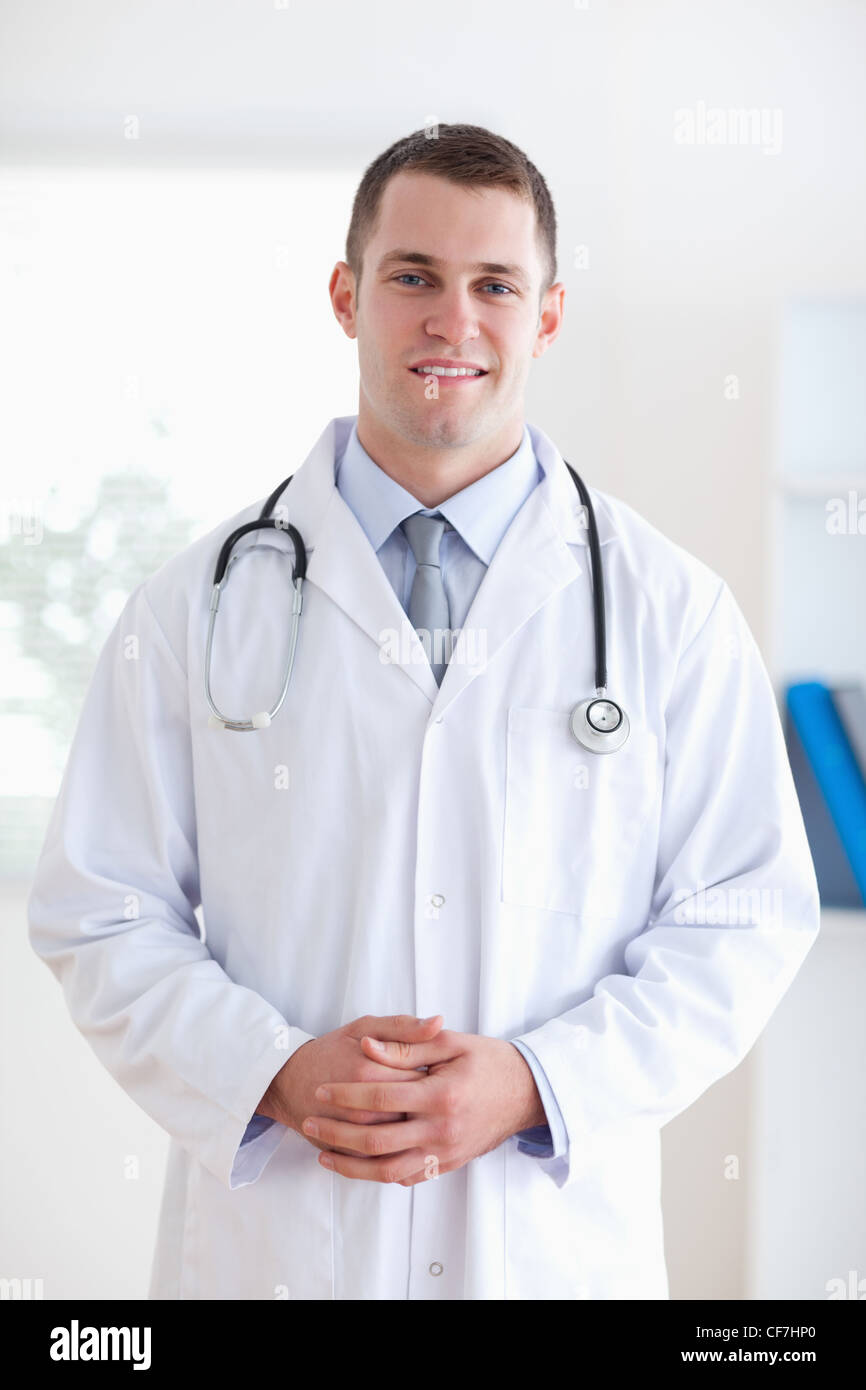 Doctor with fingers folded - Stock Image
