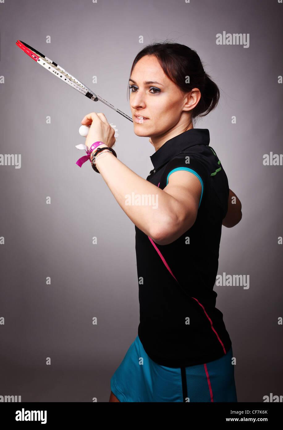 portrait of caucasian woman play badminton - Stock Image