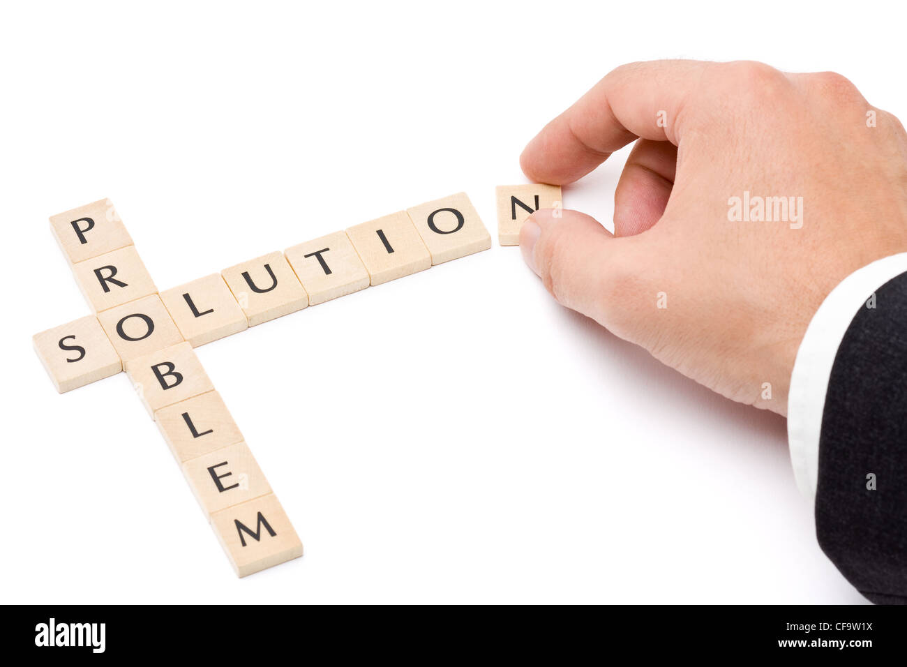 Business man building solution from problem over white background - Stock Image