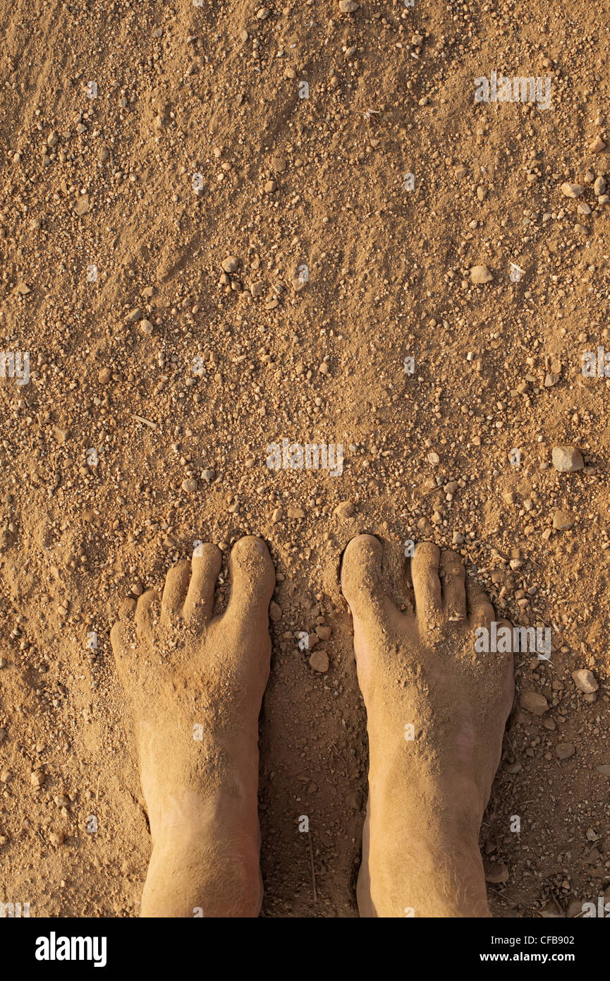 Dusty dirty covered feet. India - Stock Image