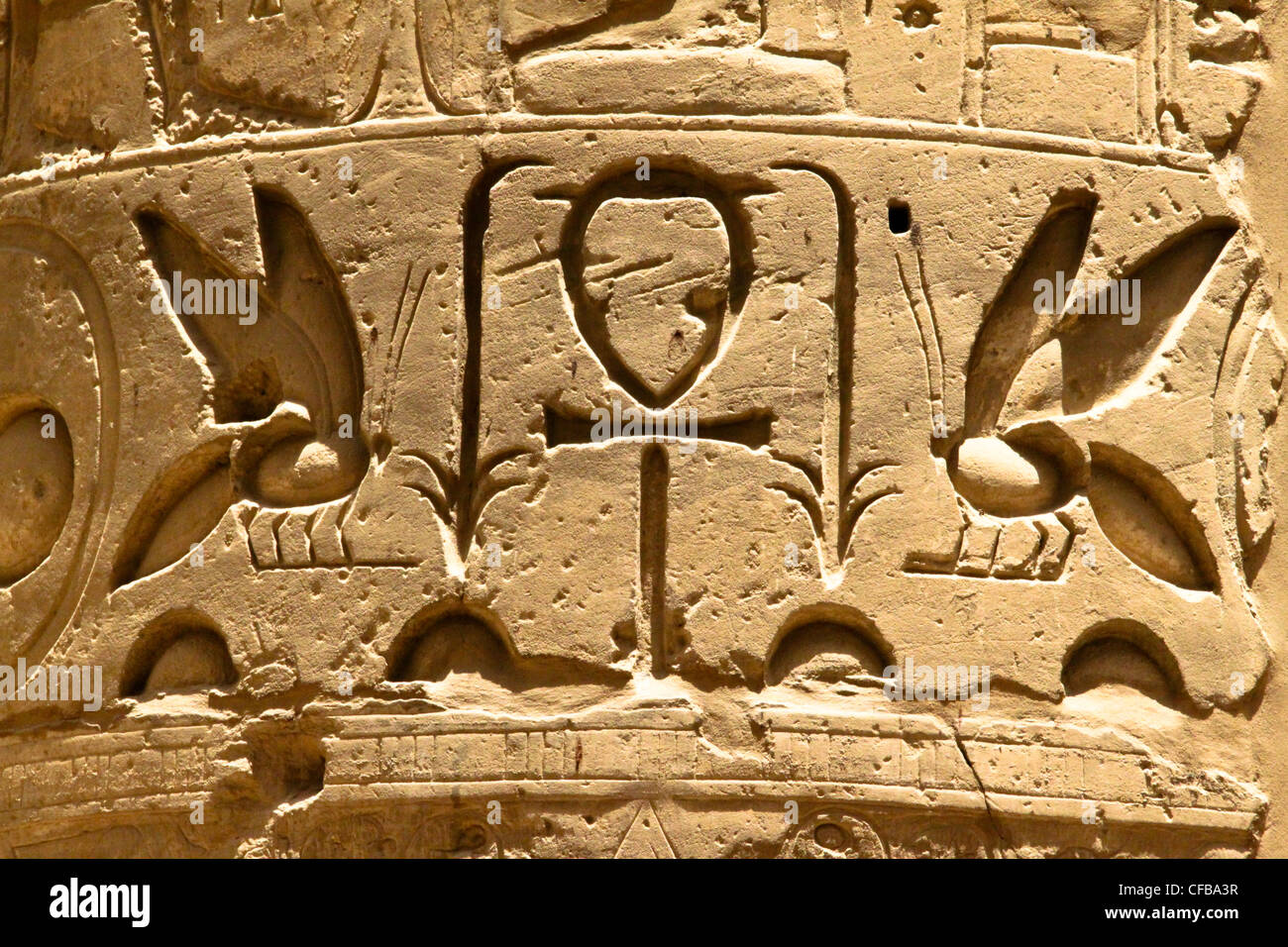 Hieroglyphics in bas-relief in the columns of the great temple of Karnak dedicated to the worship of Amun, in the Stock Photo