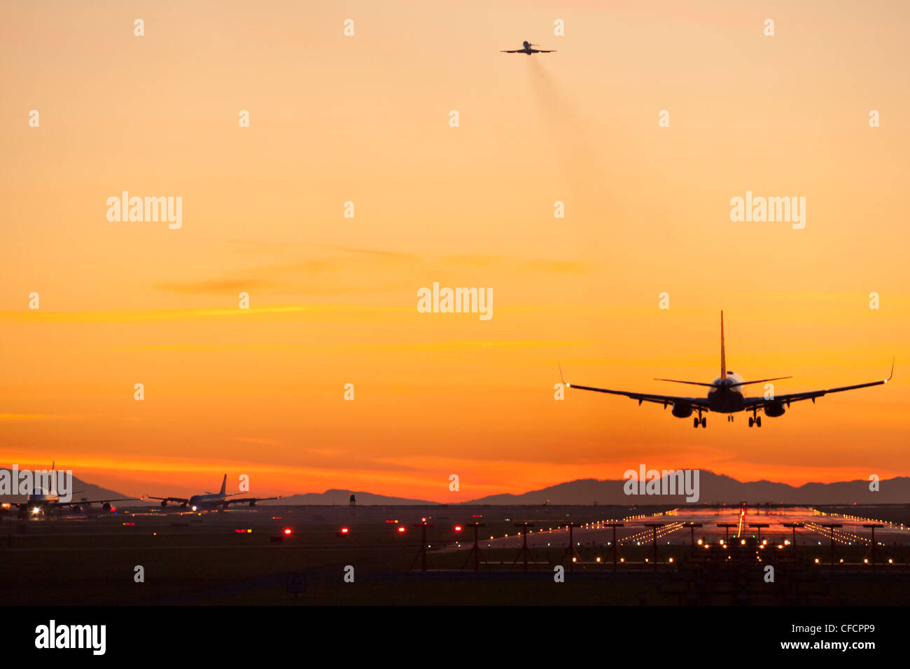 Inbound, outbound and taxiing aircraft. - Stock Image