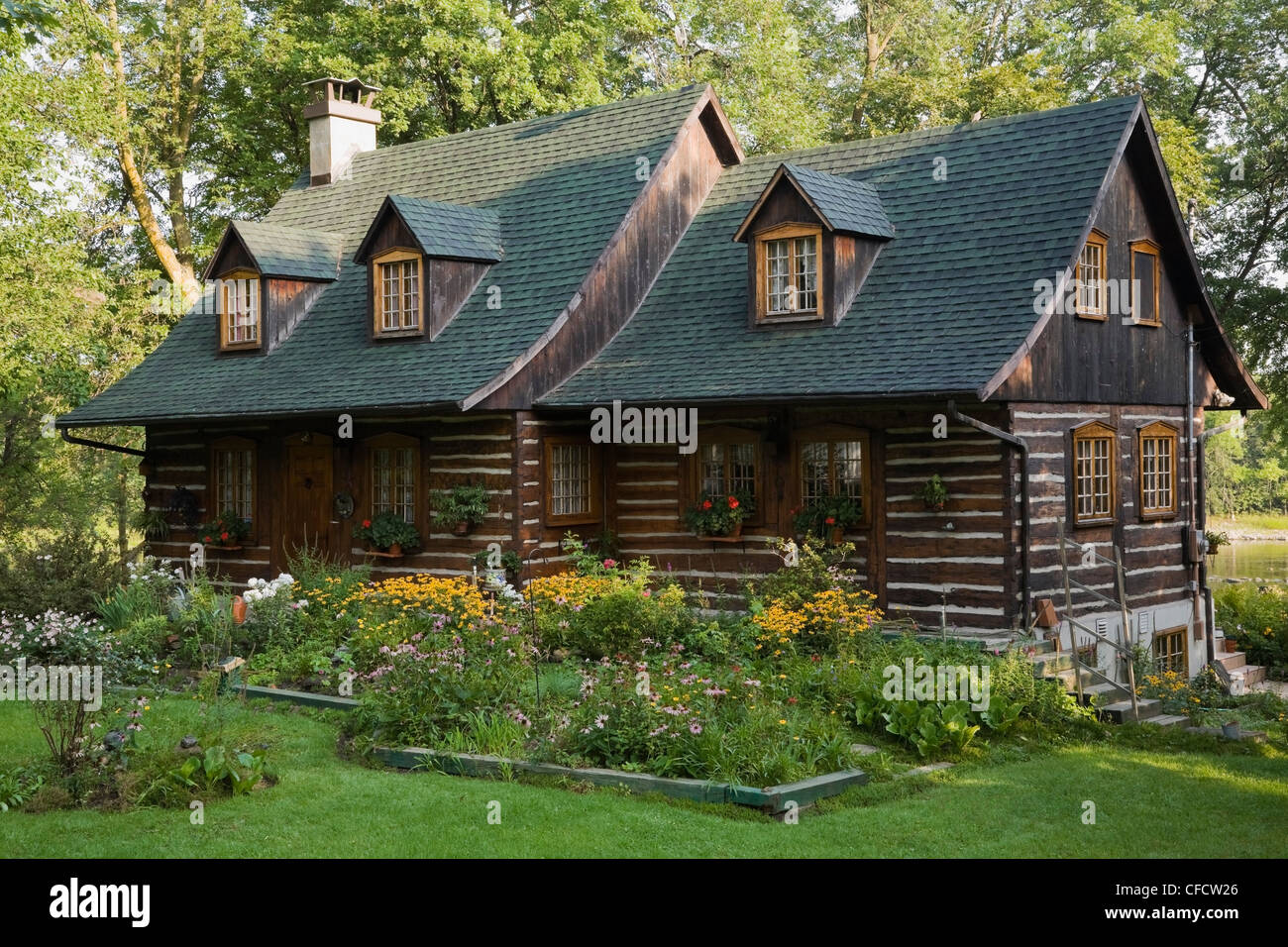 Reconstructed Old Canadiana (1977 replica) cottage style Residential Log Home, Quebec, Canada. - Stock Image