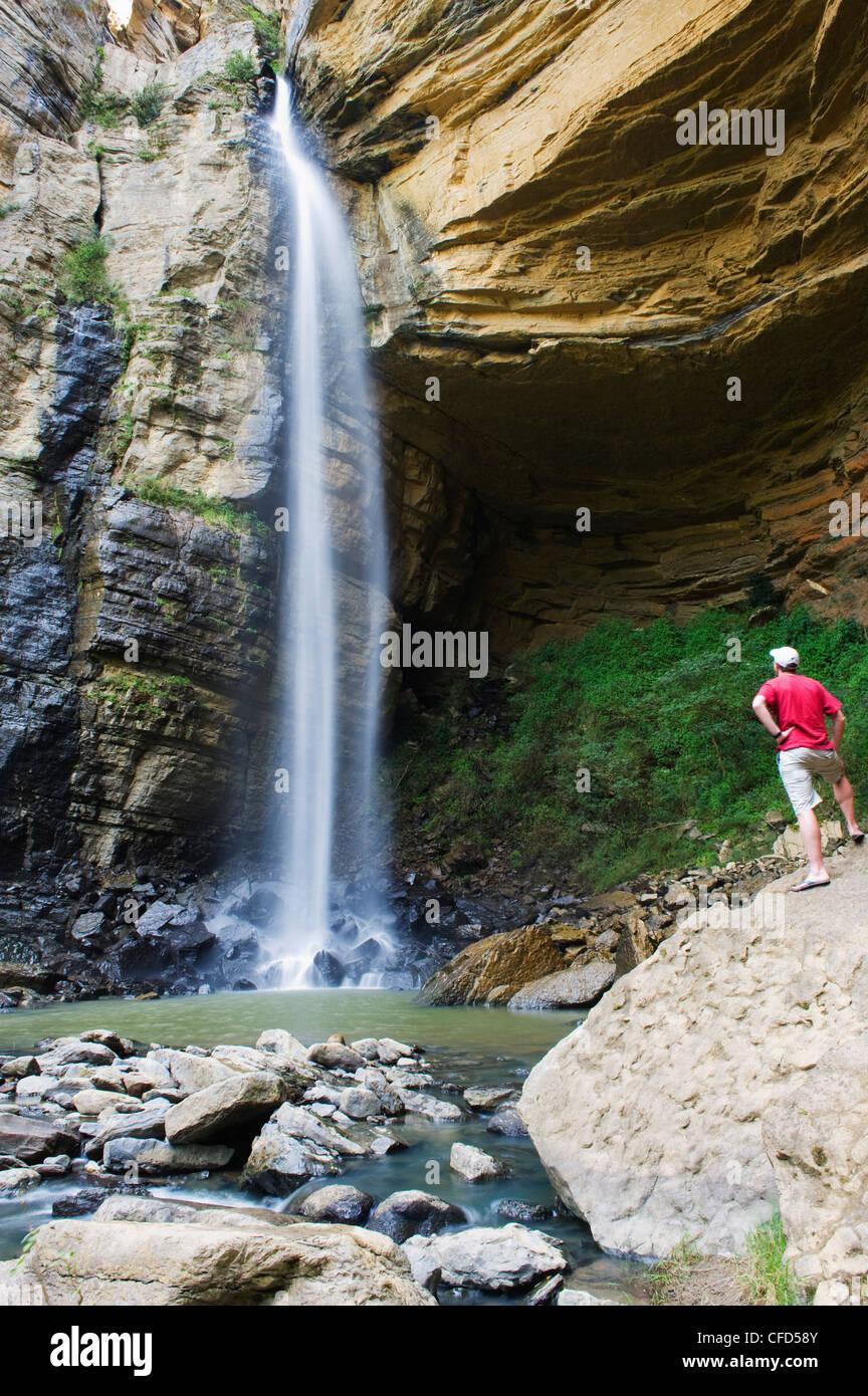 Tourist at El Hayal Waterfall, Santa Sofia, near Villa de Leyva, Colombia, South America - Stock Image