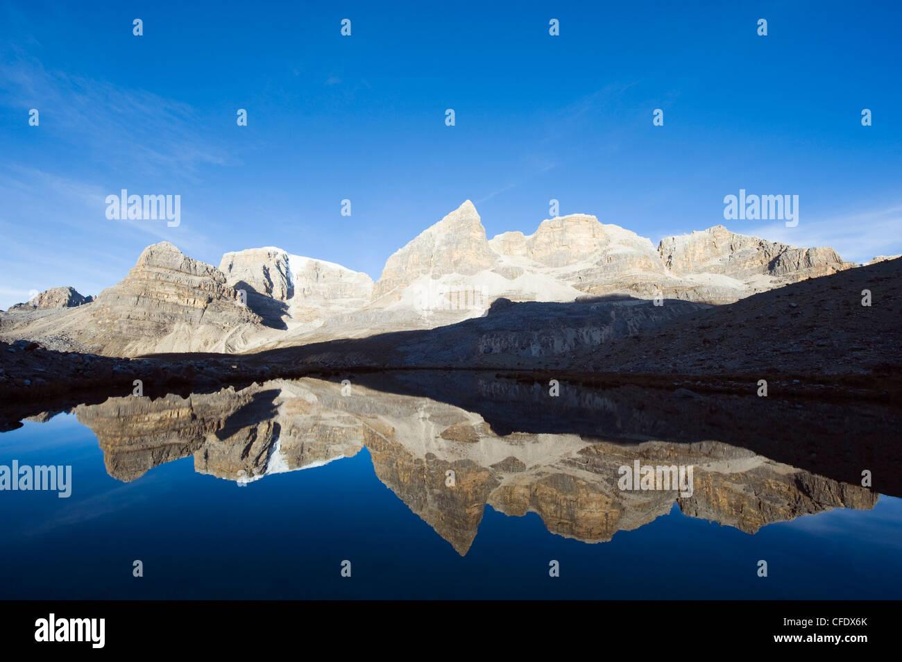 Reflection of mountains in Laguna de la Plaza, El Cocuy National Park, Colombia, South America - Stock Image