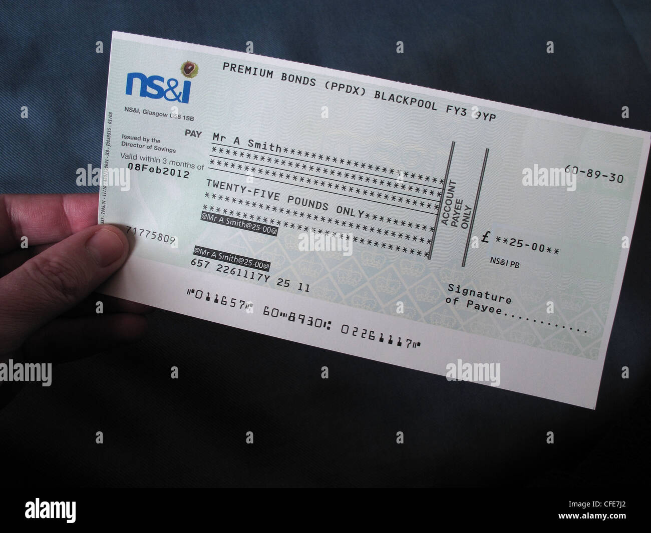 NS&I,premium,bond,cheque,held,in,a,hand,of,the,winner,check,lottery,win,British,National,Savings,ERNIE,E.R.N.I.E.,gotonysmith,£25,25,pound,pounds,premiumbond,investment,investments,Electronic,Random,Number,Indicator,Equipment,bonds,Blackpool,hands,holding,a,numbers,cashed,cashing,odds,prize,GPO,General Post Office UK GB Great British English luck lucky,gotonysmith,Buy Pictures of,Buy Images Of