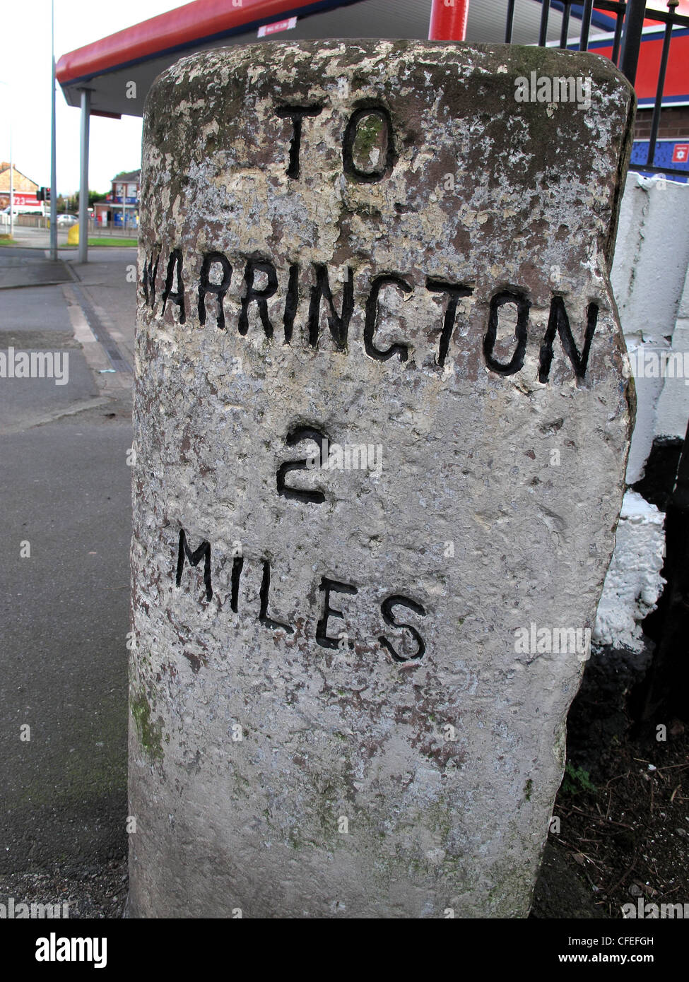 Milepost,To,Warrington,2,Miles,Two,Grey,stone,on,A57,at,Liverpool,Road,rd,Penketh,Cheshire,England,UK,gotonysmith,history,historic,victorian,old,olde,fashioned,oldfashioned,ancient,gotonysmith,Warringtonians,Buy Pictures of,Buy Images Of