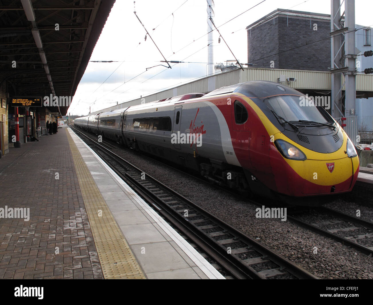Virgin,Voyager,intercity,train,arrives,at,Warrington,Bank,Quay,Railway,Station,Looking,south,west,coast,westcoast,main,line,mainline,gotonysmith,electric,electrified,lights,on,light,headlight,head,Parker,Street,st,Branson,Branston,Richard,Pendo pendolino Glasgow Euston,gotonysmith,Warringtonians,Buy Pictures of,Buy Images Of