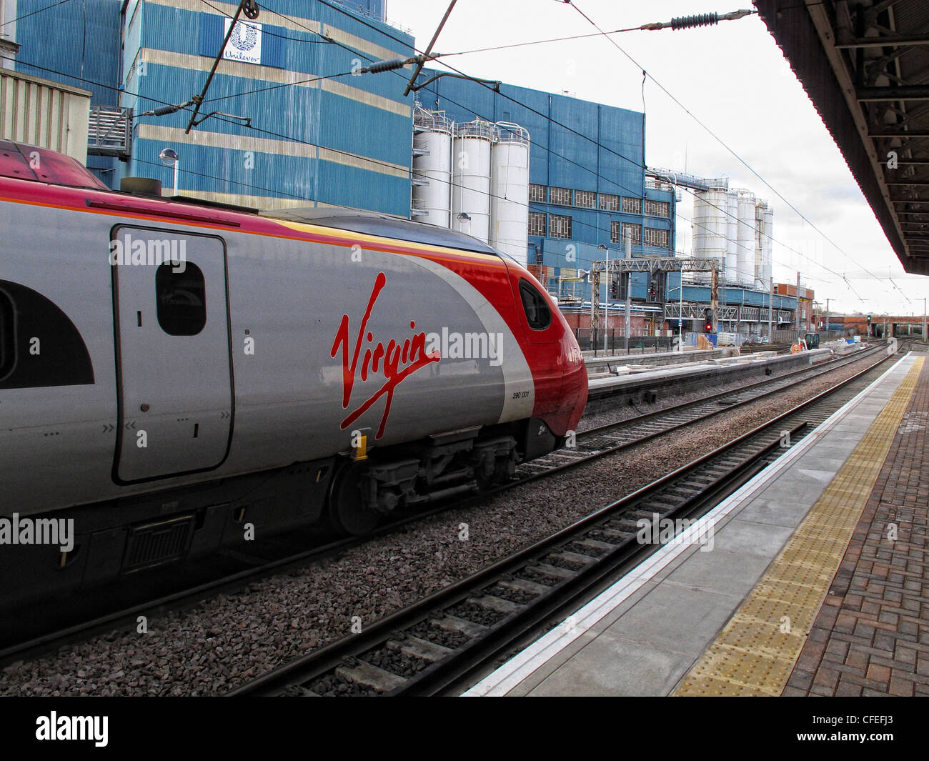Virgin,Pendo,Pendolino,train,standing,at,platform,three,3,gotonysmith,Warrington,Bank,Quay,railway,station,Parker,St,Warrington,Cheshire,Voyager,express,west,coast,main,line,mainline,westcoast,Unilever,factory,background,Crossfields,Crossfield,Lever,Bros,Brothers,local,intercity,arrived,arriving,Glasgow,Euston,Birmingham,Crewe,depart,departing,looking,up,the,platform,toward,towards,north,NW,no,kissing,nokissing,gotonysmith,Warringtonians,Buy Pictures of,Buy Images Of