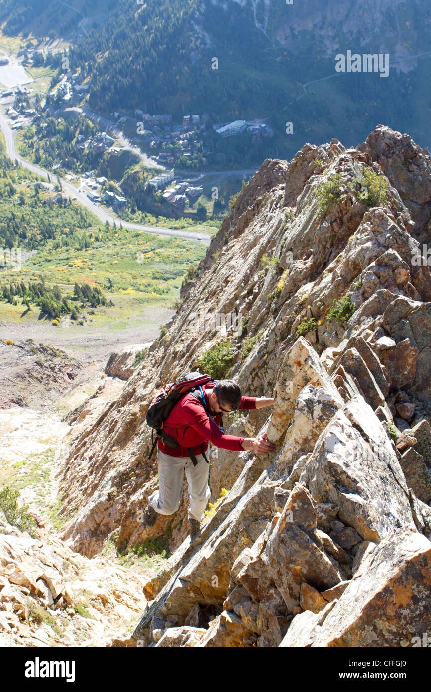 A man enjoying a fall hike on the South Ridge of Mt Superior, Utah - Stock Image