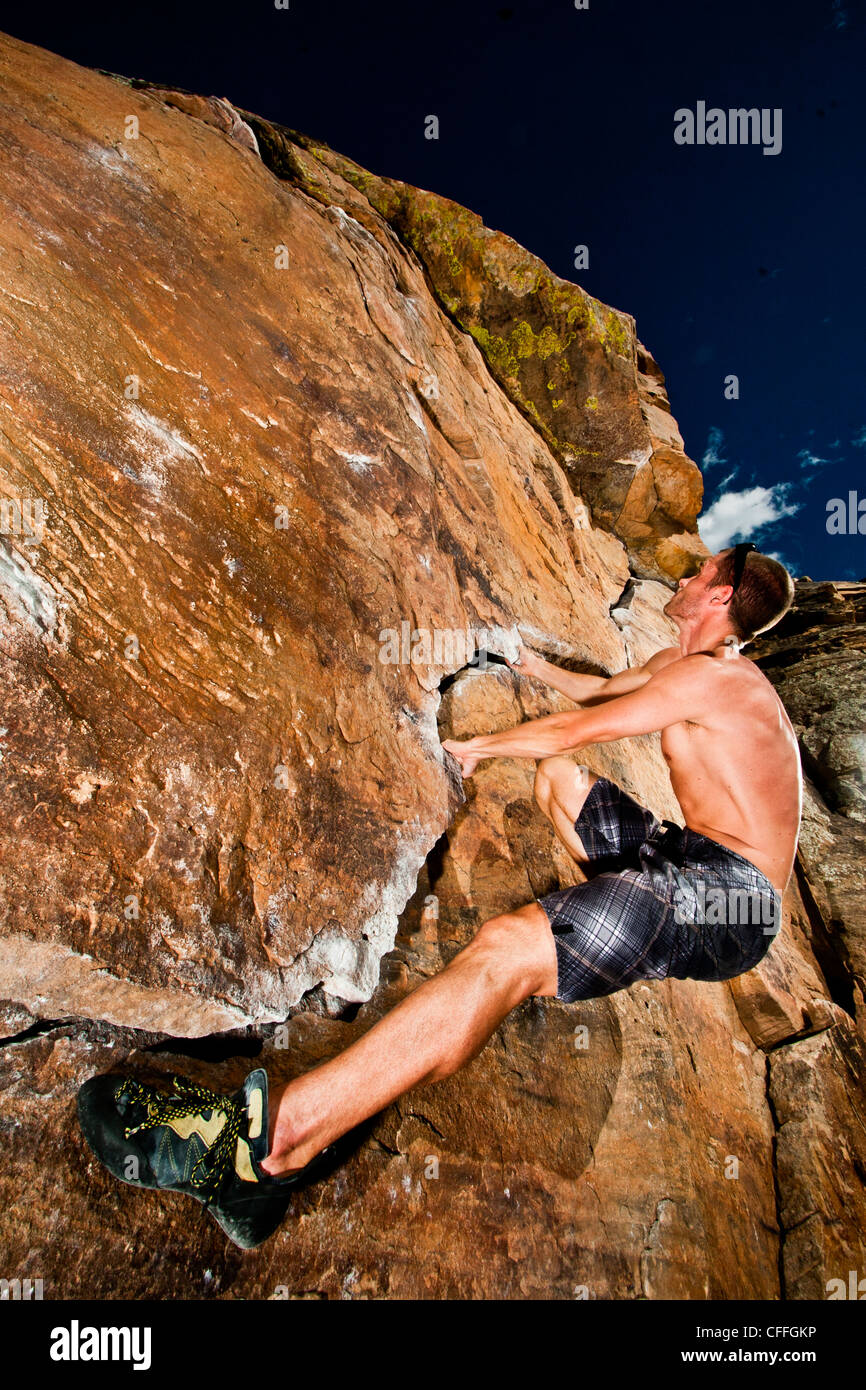 Rock climber climbing the Prow at Rotary Park adjacent to Horsetooth Reservoir in  Fort Collins, Colorado, USA - Stock Image