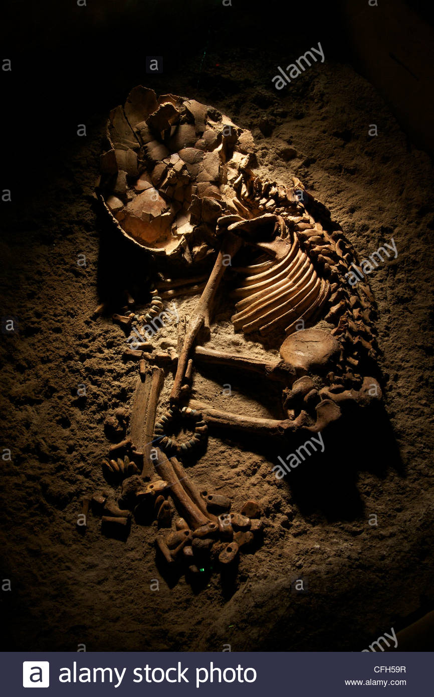Skeletal remains of an infant adorned with stone and bone beads found at Catalhoyuk. Stock Photo