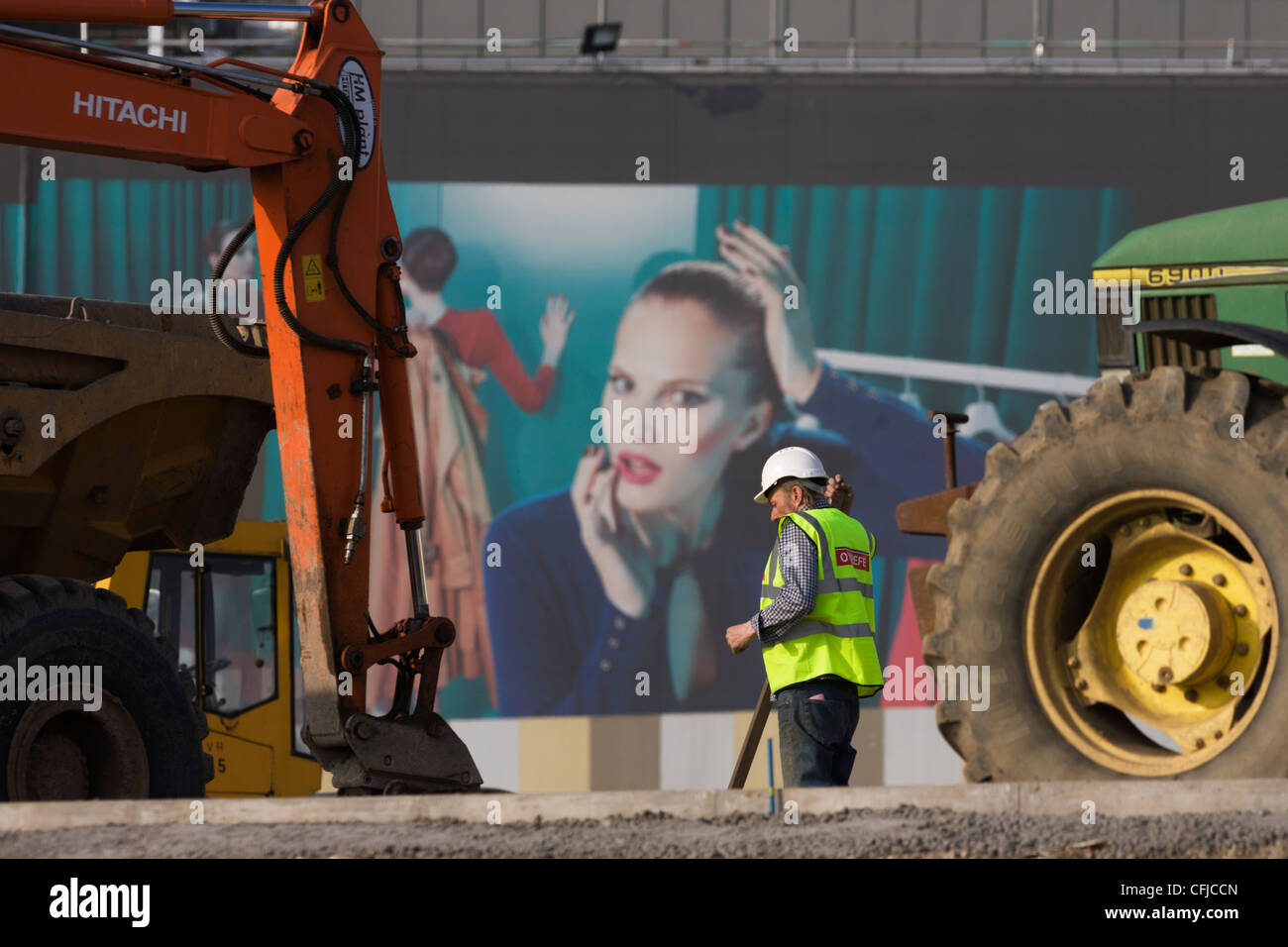 an-excavator-and-aspirational-poster-on-