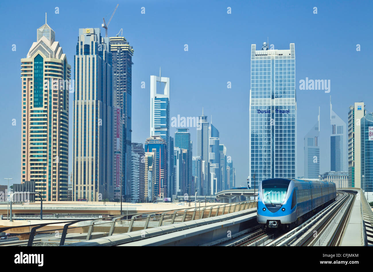 Sheikh Zayed Road skyline of high rise buildings and skyscrapers, and metro train, Dubai City, United Arab Emirates, - Stock Image