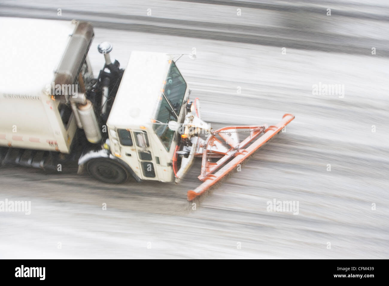 USA, New York State, New York City, high angle view of Snowplow plowing snow out of street - Stock Image